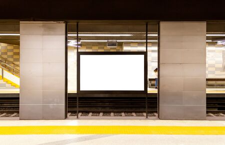 Blank billboard at the subway metro passenger station. Writing area for advertisement. Copy space 스톡 콘텐츠