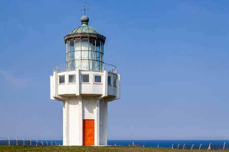 Lighthouse on blue sky background a sunny day