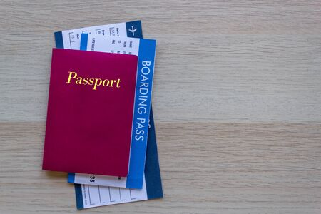 Passport and flight ticket airline travel concept