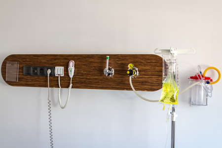 Hospital room patient bed wall equipment