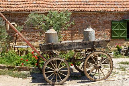 Old milkmaid horse carriage, iron milk keg