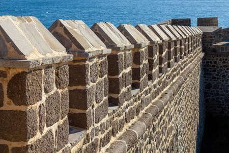 Castle defense wall with sea 版權商用圖片