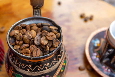 Coffee beans in a coffee pot. Turkish coffee concept
