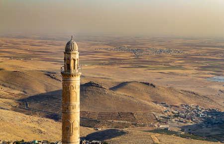 Mardin Ulu Cami Mosque minaret and Mesopotamia Valley view. Turkey