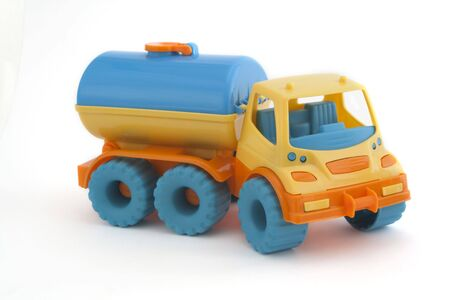 childrens toy tank car on a white background photo