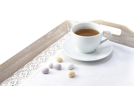 Easter tea with colored candies photo