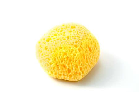 porous: Yellow porous sponge isolated on white