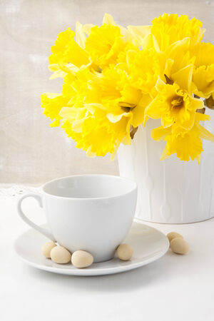 Bouquet of yellow narcissus on the table photo