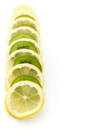 frozen glass: Kiwi and lemon on a white background
