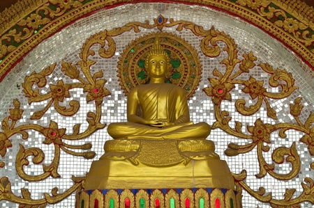 Buddha statue is art Thailand  Artistic low relief in front of the temple  photo