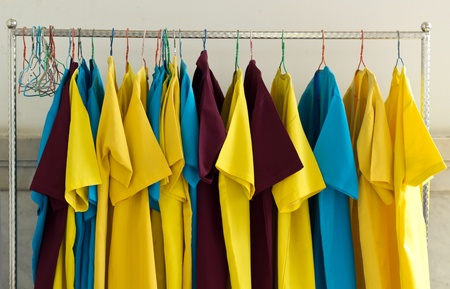 A clothesline for hang multiple shirts  and clothes  photo