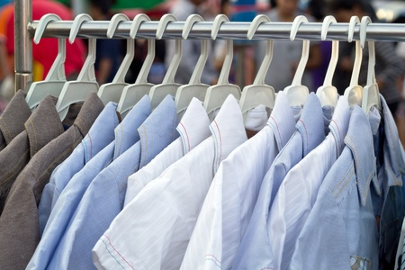 purchased: Multiple shirts on the rail waiting to be purchased  Stock Photo