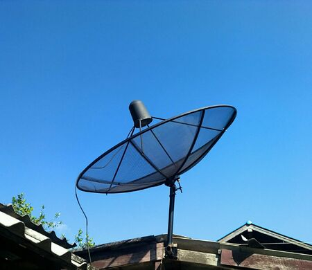 connection connections: Satellite dish on roof Stock Photo