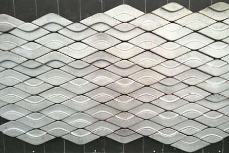 tile: Wave pattern on brick wall