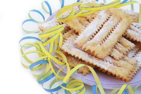Italian carnival pastry on white. Traditional carnival pastry, chatter or crostoli, lies, rags.