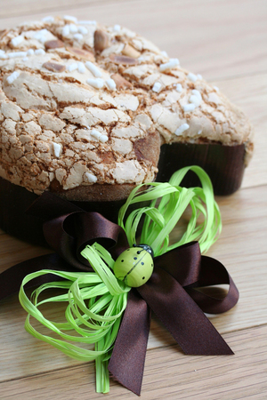 Sweet Easter cake named Colomba. Italian traditional pastry on wooden background Banco de Imagens