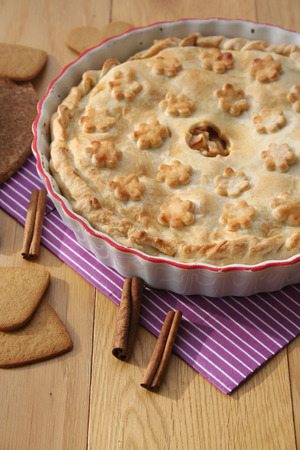 homemade  pie with cinnamon and cookies on wooden table Stock Photo