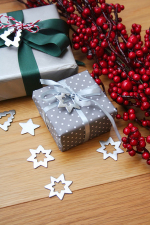 Christmas silver gift boxes on wooden table. Christmas festive background