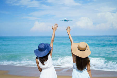 beach, beach front, beautiful, couple, destination, family, female, girl, hand up, happiness, happy, holiday, lifestyle, love, man, motion, nature, ocean, outdoors, people, plane, sand, say hi, sea, s