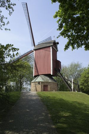 Windmill on a hill seen from below photo