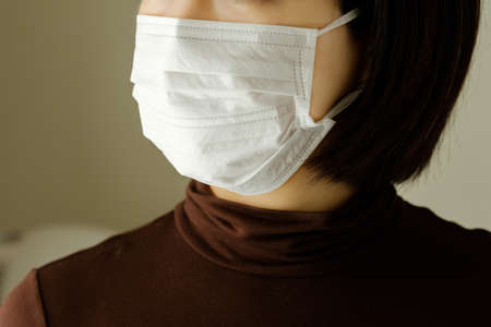 A woman wearing a mask to prevent infection Banco de Imagens