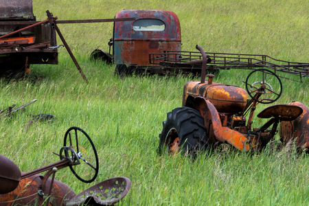 Old Rusted Tractors in Field Green Grass 写真素材