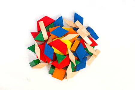 Multicolored wooden blocks. View from above. Macro.White wooden background.Isolate.