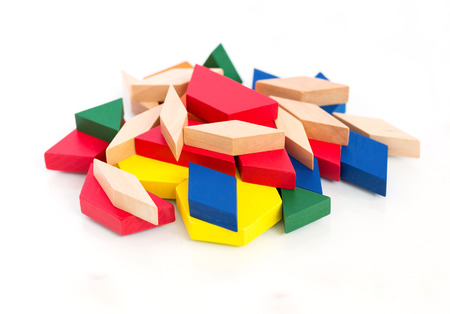 Multicolored wooden blocks.Macro.White wooden background.Isolate.
