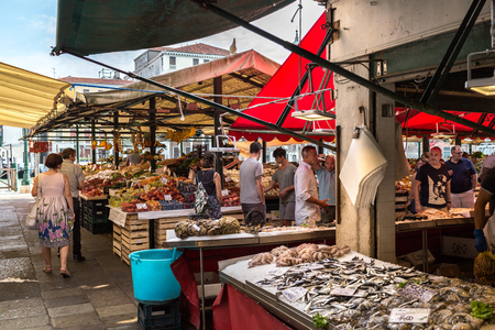 the merchant of venice: Venice, Italy - September, 2016: Rialto Fish Market. Fresh seafood is displayed on crushed ice. Shellfish, fish, squid, vegetables and fruits