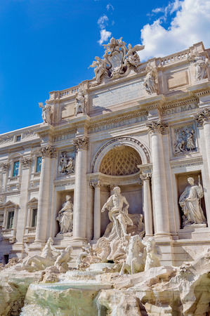 Trevi Fountain in Rome, Italy. The tradition of throwing coins into a fountain.