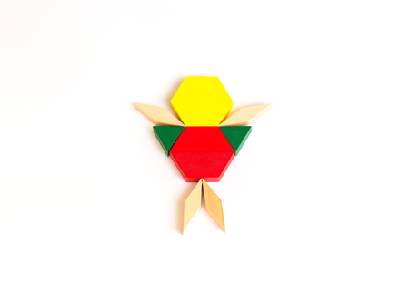 Figurine of man from colored wooden cubes blocks. White background.