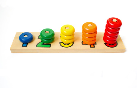 Wooden colored blocks, rings. Game for learning account Stock Photo