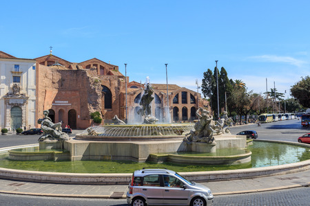 angels fountain: ROME, ITALY - SEPTEMBER 8 2016: Fountain in Piazza della Repubblica in Rome, with the Basilica of St. Mary of the Angels behind