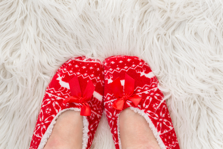 New Years, Christmas slippers for adults are dressed for the women. On white soft fur. Funny, funny, humorous, cozy,