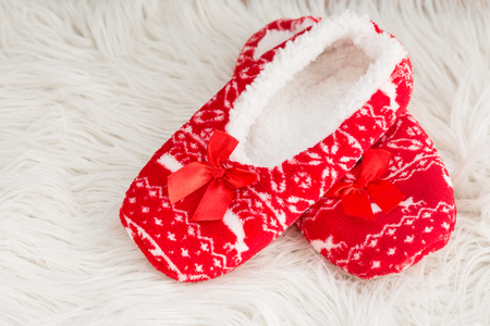 New year, Christmas slippers on white soft fur. Funny, funny, cozy