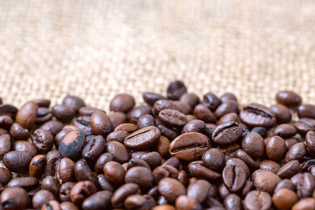 Coffee beans on a wooden background, on canvas