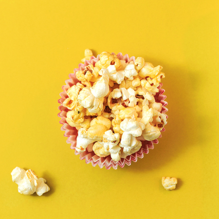 Popcorn on a yellow background. Square