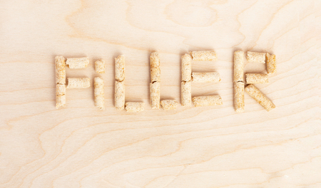 Text Filler made of filler for toilets of cats. View from above
