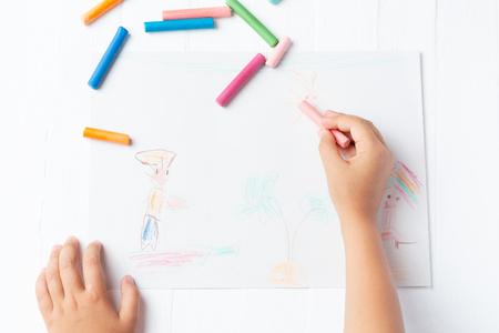 A girl draws a crayon, a pastel, a journey through the sea. Ship, sailor, boy, palm, sea 스톡 콘텐츠