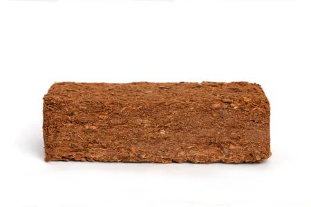 Block of Coconut Coir Husk Fiber isolated on white background.