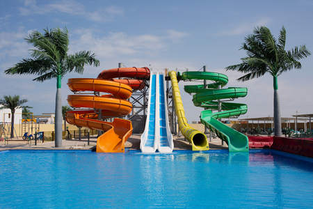 Multicoloured big water slide in the public swimming pool Stock Photo - 119762173