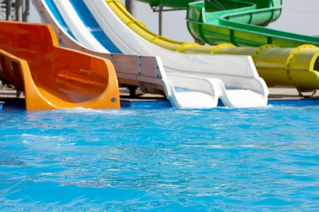 Multicoloured big water slide in the public swimming pool Stock Photo - 119762177