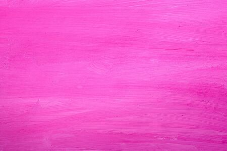 Pink background painted with paints on white paper.