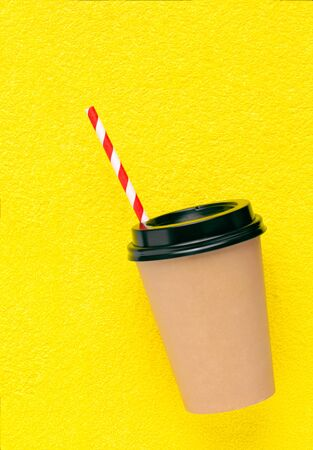Paper Coffee cup to take away on yellow background. Stock fotó
