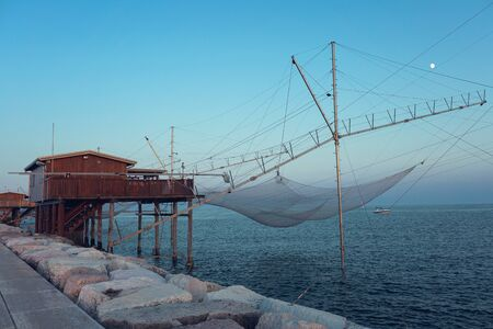 Traditional Fishing nets House in Chioggia at sunset.
