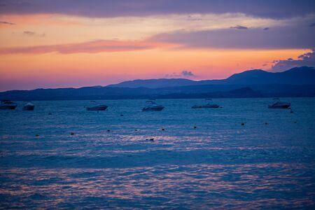 Beautiful evening, sunset overlooking Lake Garda, Alps, mountains. After the rain
