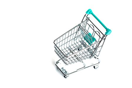 Miniature empty shopping cart turquoise color on white background. isolated. Top view, flat lay. Stock fotó