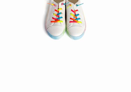 Close up running shoes with rainbow laces for the child on a isolated backgroun. Top view.