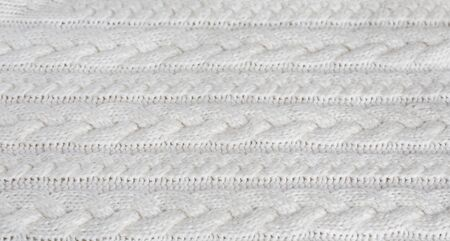 Knitted warm white winter sweater. Huggy style