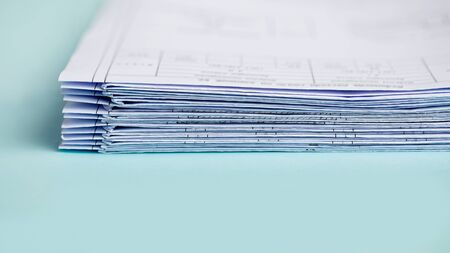 Stack Folding drawings on a blue background. Copy space. Archivio Fotografico